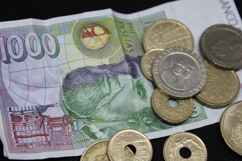 Billetes y monedas. Foto: Manos Unidas