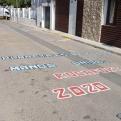 Pintada de sensibilización en la delegación comarcal de Rocafort de Manos Unidas Valencia.